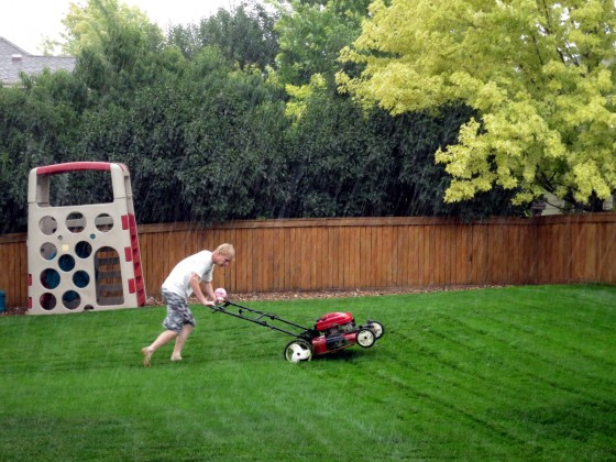 alex-mowing-in-the-rain